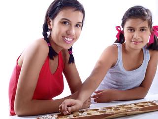 girls playing mancala