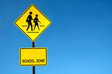 school zone sign with blue sky