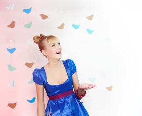 studio portrait of young happy girl