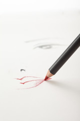 a make-up sketch, with a red lip pencil drawing the mouth