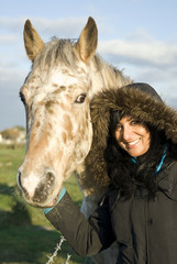 Beautiful asian woman with appaloosa horse.