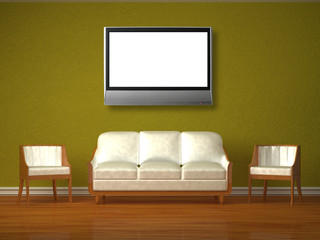 White couch and two chairs with lcd tv in green interior