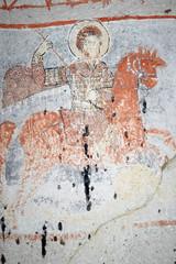 Ancient fresco in Cappadocia. Saint George killing the dragon