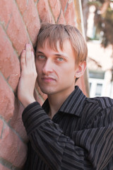 Young man near a wall