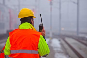 worker with orange jacket