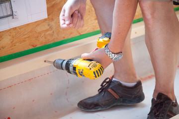 fixing a wooden slat