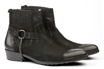Pair of black male western style shoes on white