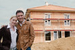 couple infront of new house