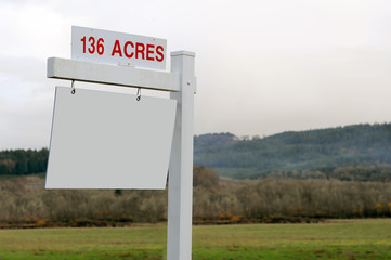 136 Acres of Land For Sale Sign