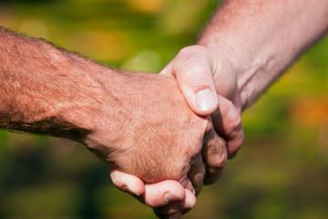 Firm handshake between two men