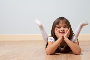 Lying cute girl on floor