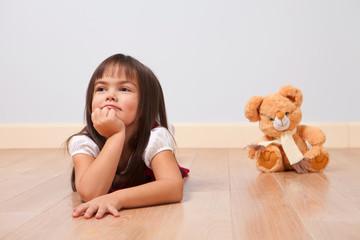 Cute girl on a wooden floor