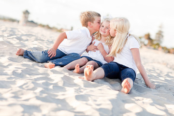 Adorable Sibling Children Kissing the Youngest