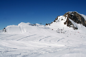 Skiers and lift on mountainside