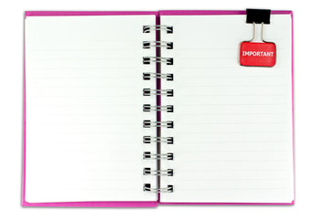 A blank notebook with a clip . The clip is positioned in a top position. Isolated on a white background.