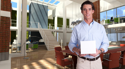 Young man with a box in a modern office