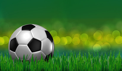 football on grass with green lighting background