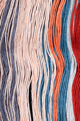 Multicolored embroidery threads backgrounds