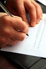 Men hand with pen sign documents