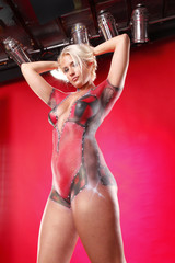 Full body gorgeous blond in racing body paint