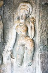 Statue in ancient rock temples at Ajanta ,  India
