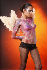 Body painted model with fluffy flowery wings