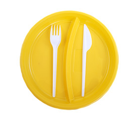 Yellow plastic plate, fork and knife