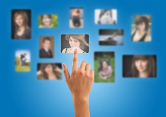 Man hand choosing photos