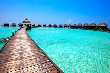 Maldives. .Villa on piles on water.