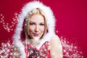 weihnachtsfrau pustet schneesterne