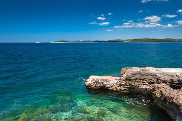 Adriatic sea scenic view. Focus on stones on foreground