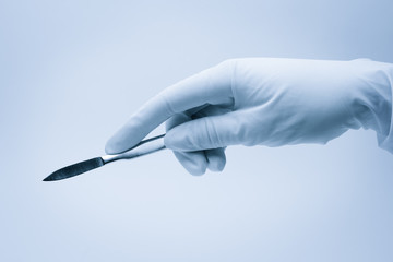 hand of surgeon with scalpel during surgery