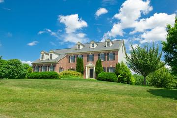 Suburban Hillside Single Family House Georgian Colonial Blue Sky