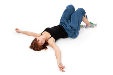 young girl lying on a white floor