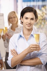 Portrait of businesswoman celebrating