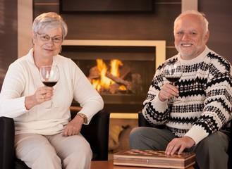 Happy senior couple having wine