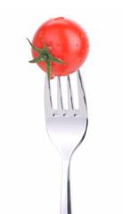 Tomato on a fork isolated on white background.