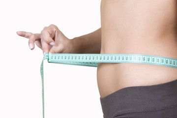 healthy lifestyle concept, woman body part measuring waist
