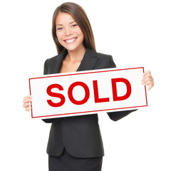 Realtor / Real estate agent woman sold sign on white background