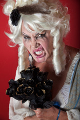 Woman dressed as scary Marie Antoinette