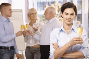 Businesswoman holding holding glass of champagne