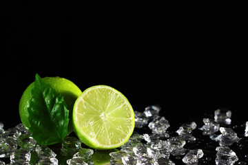 Aluminium Prints Slices of fruit Lime on a black background