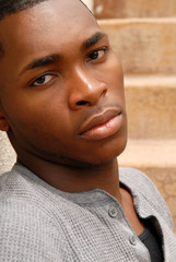 Young African American man with a sad expression