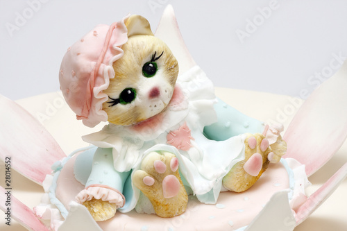 Small cute marzipan kitten for birthday cake Stock photo and