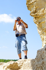 Man photograph attractions in national park.