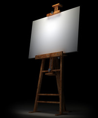 Wooden easel with blank canvas isolated on black