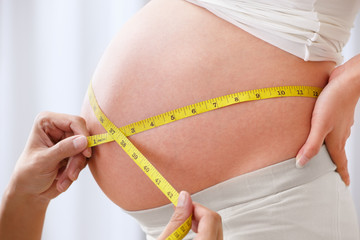 Measuring the stomach of pregnant woman