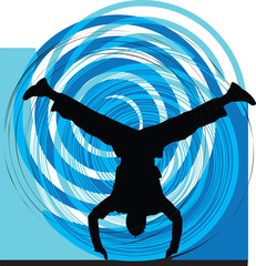 Breakdancer dancing on hand stand silhouette