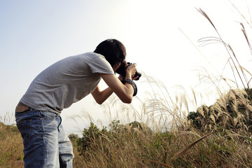 nature photographer taking pictures outdoors