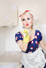 Housewife playing with soap bubbles